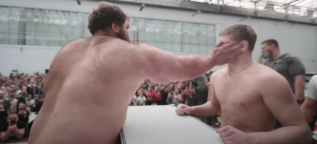 slapping competition russia viral video fat guy